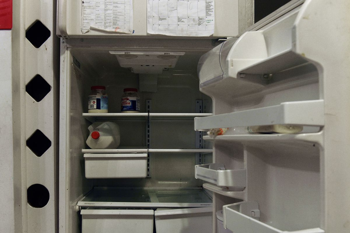 After a full month since a major food shopping trip had been taken, the refrigerator at the home of Raphael Richmond and her six children was near empty. (Photo by Michael S. Williamson/The Washington Post via Getty Images)