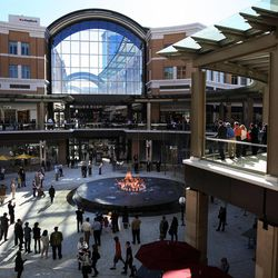 Shoppers enjoy a fountain called Transcend that shoots water and fire as City Creek Center opens in Salt Lake City, Thursday, March 22, 2012.