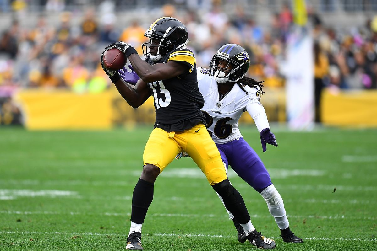 James Washington of the Pittsburgh Steelers catches a pass in front of Maurice Canady of the Baltimore Ravens during the second quarter at Heinz Field on October 6, 2019 in Pittsburgh, Pennsylvania.