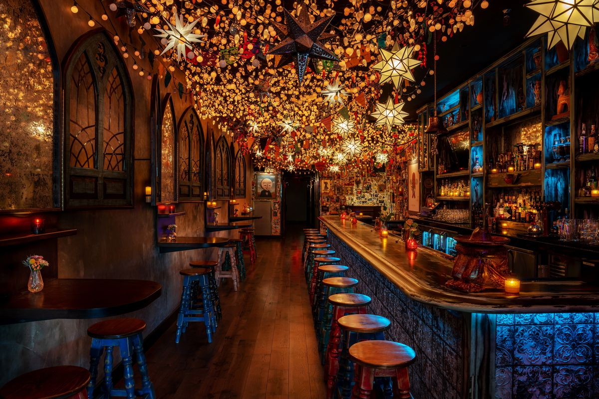 A dimly lit bar with hundreds of small lights overhead