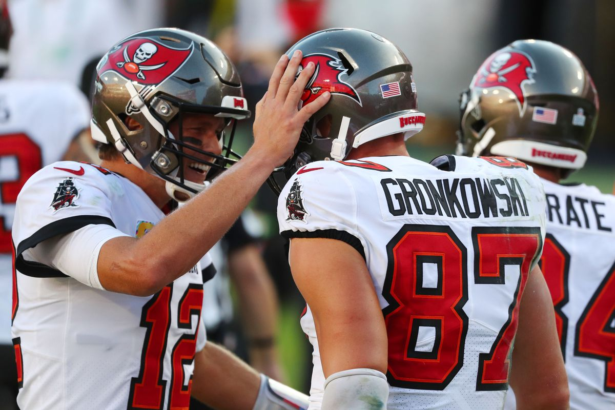 Buccaneers tight end Rob Gronkowski (87) celebrates with quarterback Tom Brady (12) after scoring a touchdown against the Green Bay Packers during the second quarter of a NFL game at Raymond James Stadium.