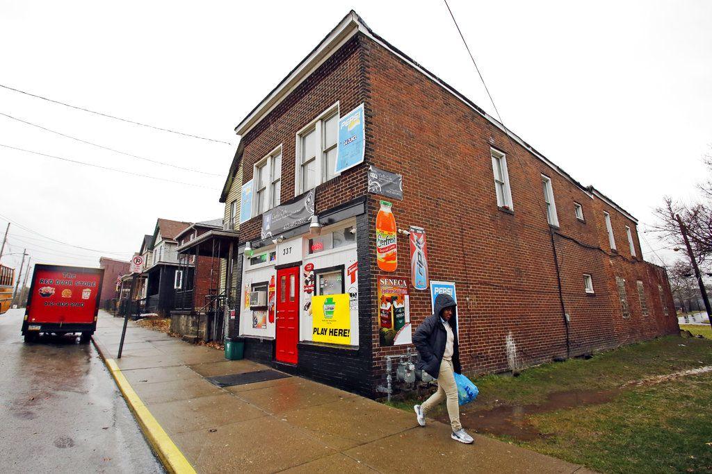 A shopper leaves Carl's Cafe in Rankin, Pa. (AP Photo/Gene J. Puskar)