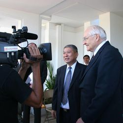 Elder L. Tom Perry and Elder Jean A. Tefan, an Area Seventy, meet with reporters outside the Papeete Tahiti Temple following its rededication Nov. 12, 2006.