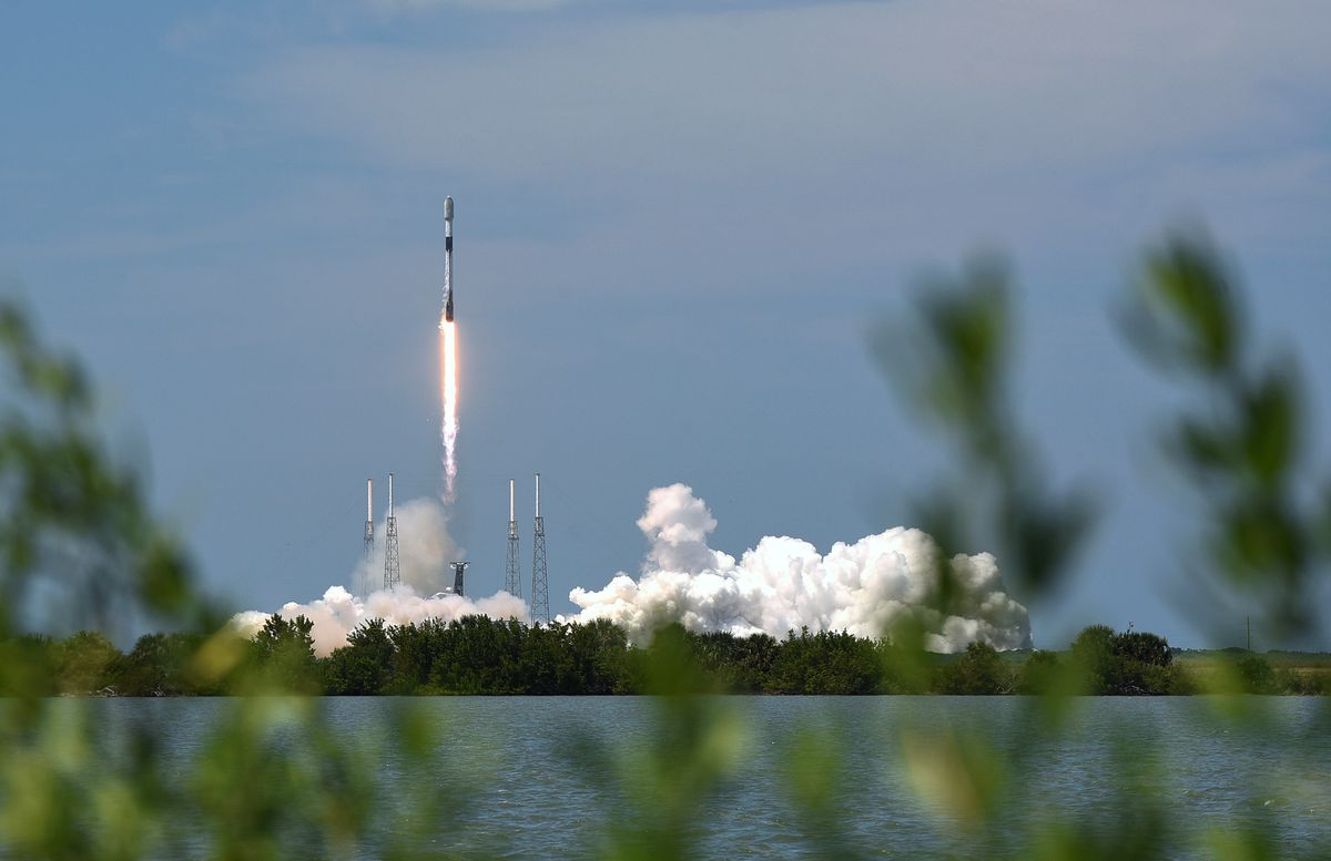 A SpaceX Falcon 9 rocket lifts off from pad 40 at the Cape...