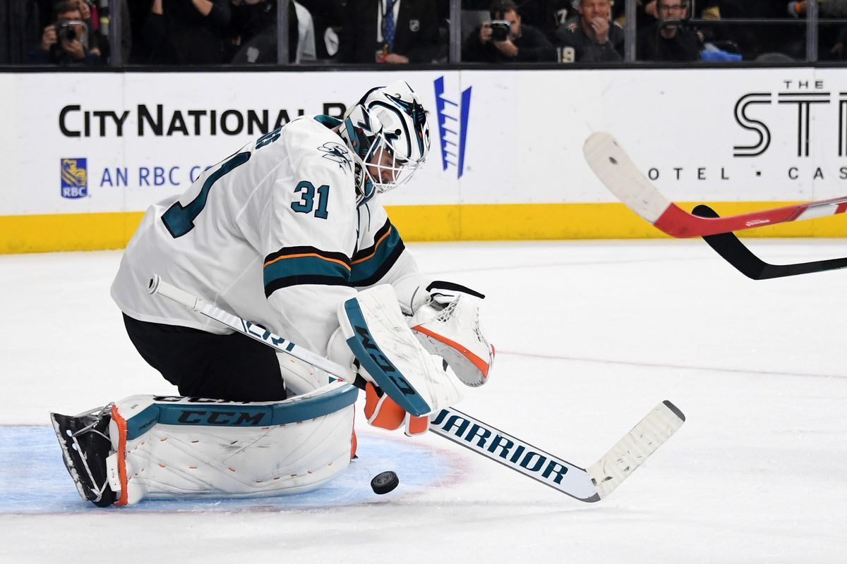 Martin Jones #31 of the San Jose Sharks blocks a Vegas Golden Knights' shot in the first overtime period of Game Six of the Western Conference First Round during the 2019 NHL Stanley Cup Playoffs at T-Mobile Arena on April 21, 2019 in Las Vegas, Nevada. T