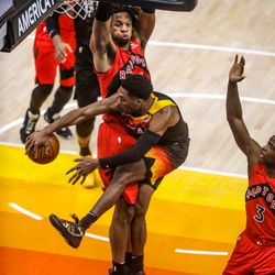 Utah Jazz guard Trent Forrest (3) wraps around Toronto Raptors forward Freddie Gillespie (55) during an NBA basketball game at Vivint Smart Home Arena in Salt Lake City on Saturday, May 1, 2021.