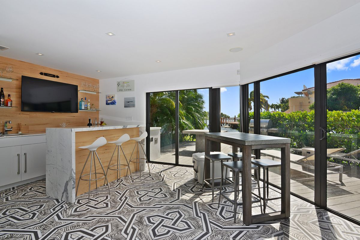 The ground floor of a townhome in Coconut Grove with a water view
