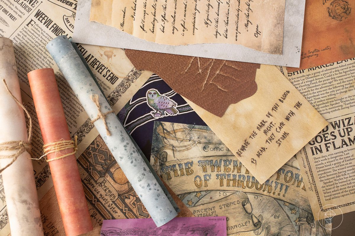 A selection of notes and hand-outs in different styles and colors, some bound with twine.