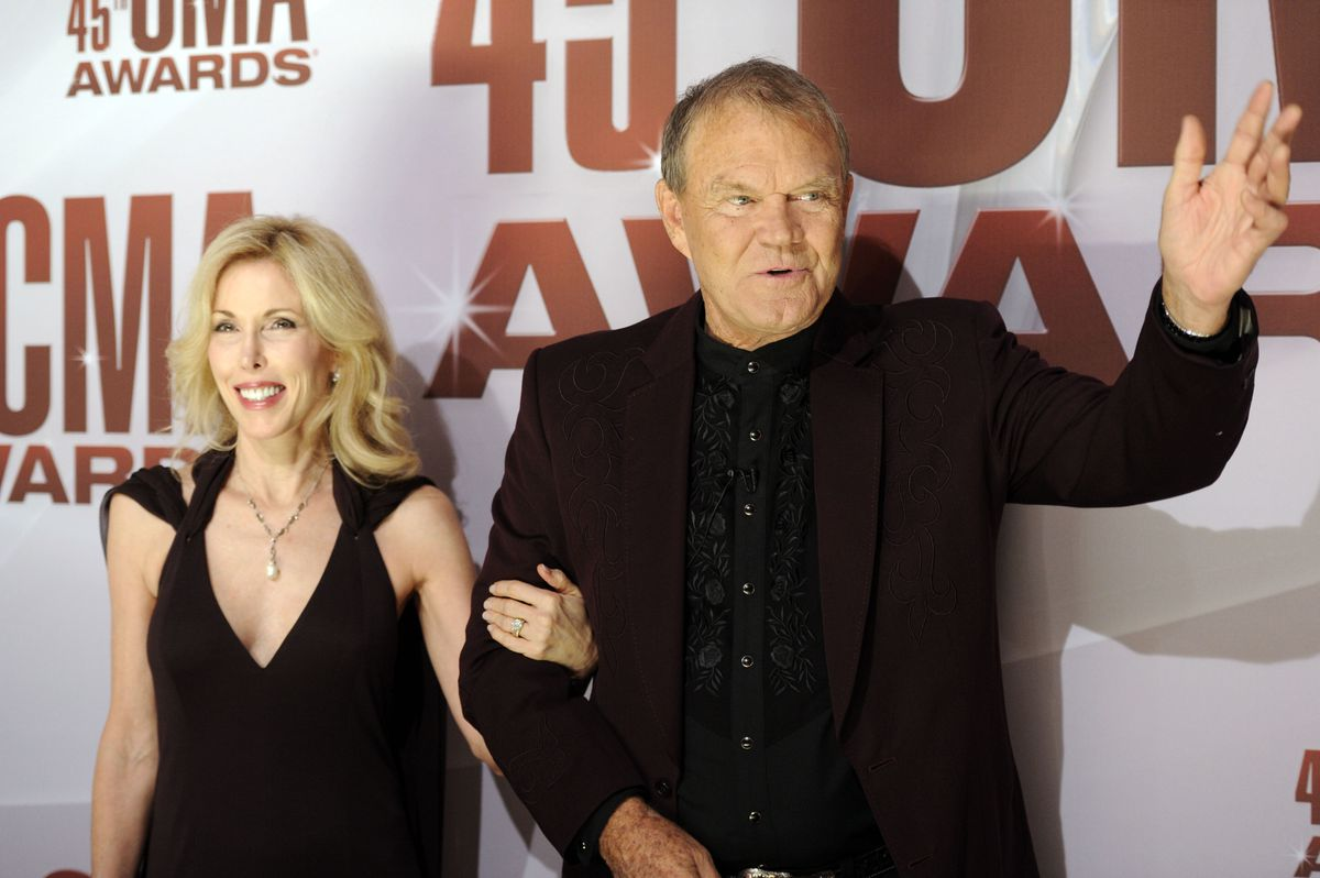 Glen Campbell and his wife Kim arrive at the 45th Annual CMA Awards in Nashville on Wednesday, Nov. 9, 2011.   AP Photo/Evan Agostini