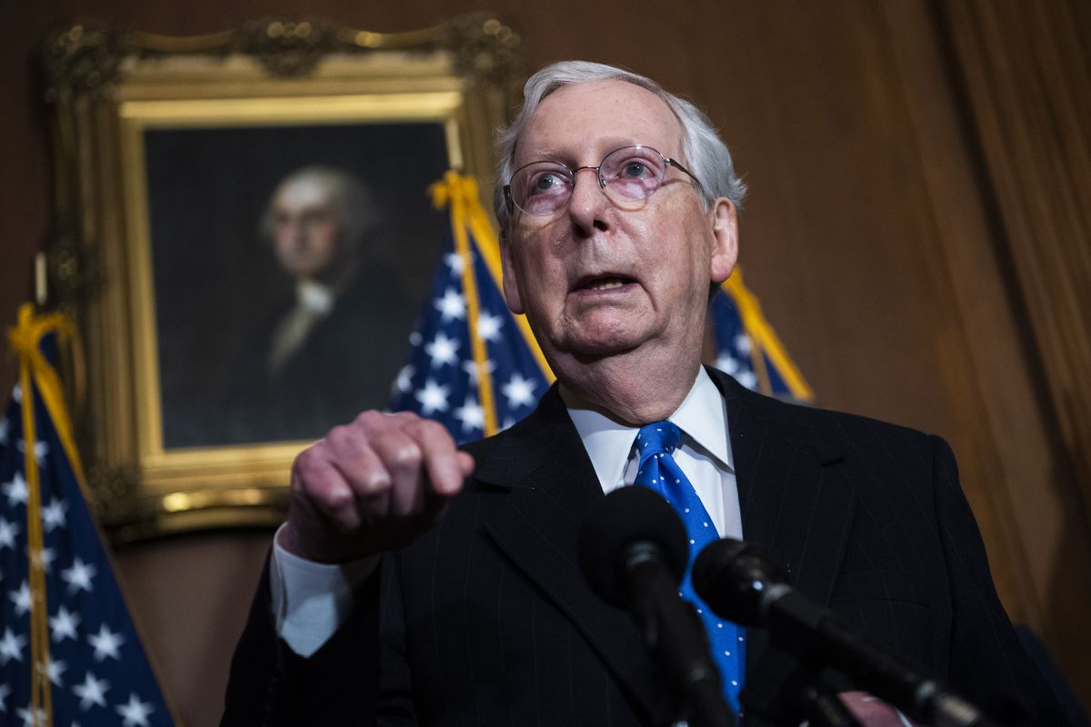 Mitch McConnell speaks into a microphone.