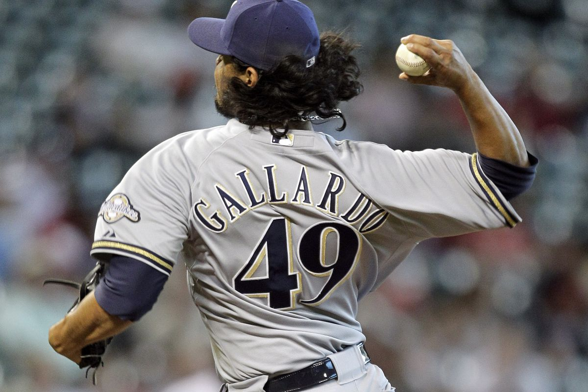 HOUSTON, TX - AUGUST 12:  Yovani Gallardo #49 of the Milwaukee Brewers pitches against the Houston Astros at Minute Maid Park on August 12, 2012 in Houston, Texas. (Photo by Bob Levey/Getty Images)