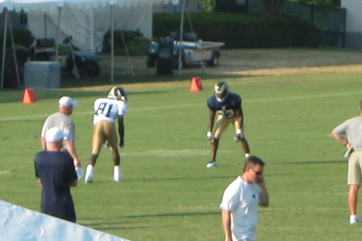 The St. Louis Rams practice while Billy Devaney works the phone.