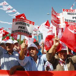 """In this Sunday, Sept. 2, 2012 photo, protesters stage a rally as thousands of Turks demonstrate to condemn terrorism in Ankara, Turkey. A Turkish official said Kurdish rebels have attacked security posts in the town of Beytussebap, Turkey, near the border with Iraq late Sunday, Sept. 2, killing nine security personnel. There has been a surge in rebel attacks in recent months. The banner reads: """"We don't want The PKK (Kurdistan Workers Party) at the parliament."""" (AP Photo)"""