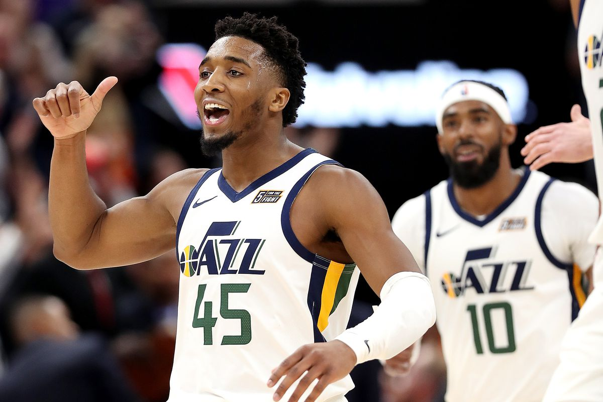 Utah Jazz guard Donovan Mitchell (45) yells to to the bench after a made shot as the Jazz open the 2019-20 season against the Oklahoma City Thunder at Vivint Smart Home Arena in Salt Lake City on Wednesday, Oct. 23, 2019. Utah won 100-95.