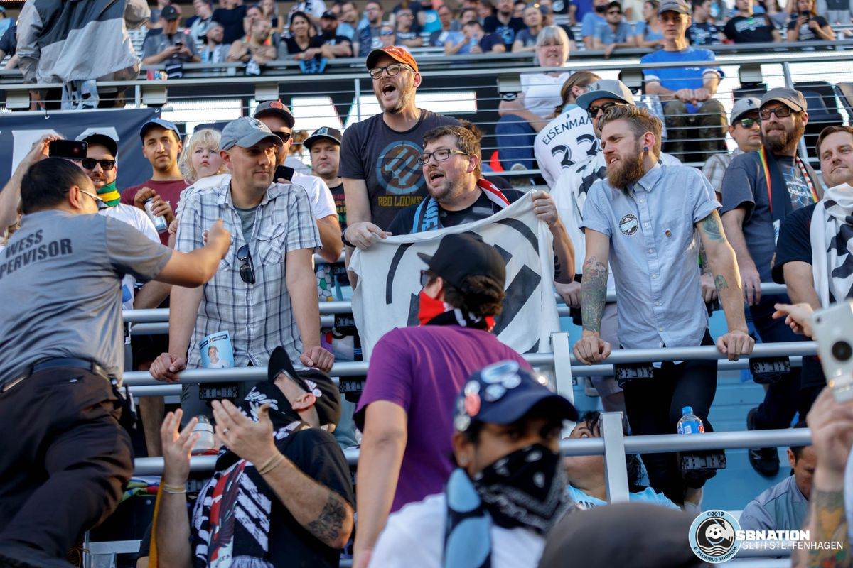 September 15, 2019 - Saint Paul, Minnesota, United States - A security guard scales the Wonderwall in an attempt to confiscate scarves adorned with Iron Front logos during the Minnesota United vs Real Salt Lake match at Allianz Field.