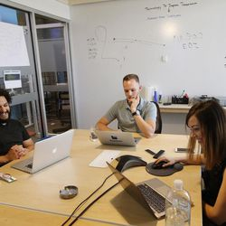 Blyncsy CEO Mark Pittman, center, meets with David Sacharny and Carlee McFarland at the company's office in Salt Lake City on Friday, July 14, 2017. Blyncsy has developed anonymized tracking of cellphones combined with data crunching to help solve transportation and movement dilemmas.