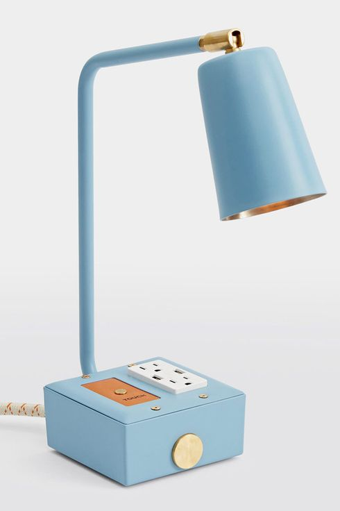 Light blue lamp with square base and elongated head.