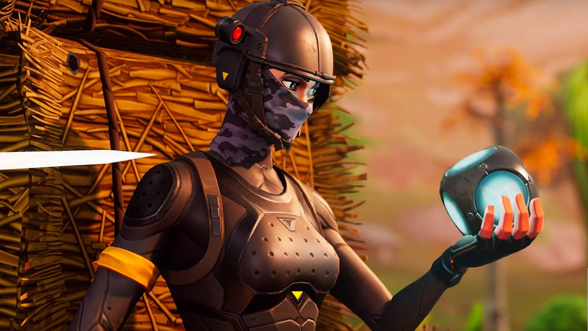 Fortnite - woman looking at a glowing cube