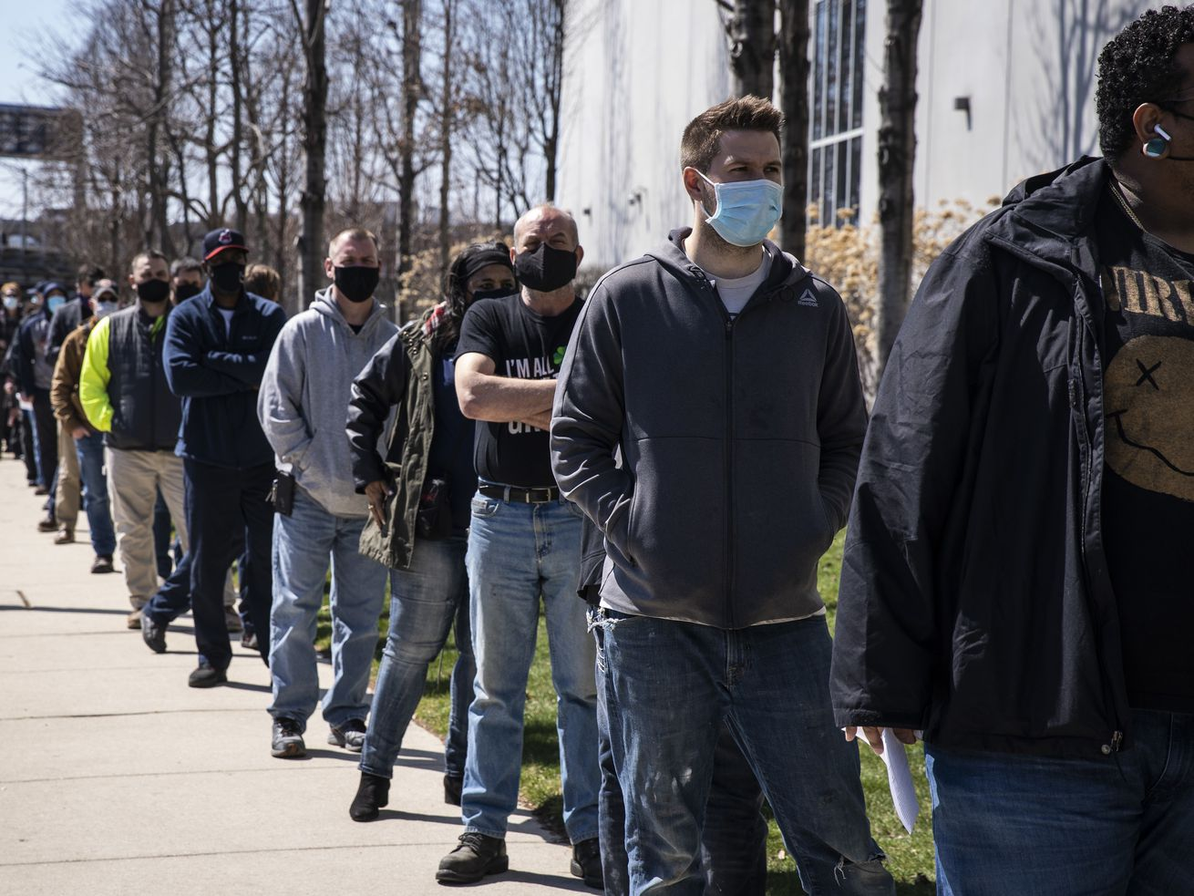 Union members line up last week for COVID-19 vaccinations at International Union of Operating Engineers Local 399 on the South Side. About 19% of Illinois residents have been fully vaccinated, but the state is facing a third surge of the virus.