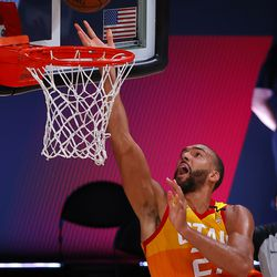Utah Jazz's Rudy Gobert slam-dunks during the second quarter of an NBA basketball game against the Denver Nuggets, Saturday, Aug. 8, 2020, in Lake Buena Vista, Fla.