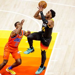 Utah Jazz guard Donovan Mitchell (45) shoots over Oklahoma City Thunder guard Theo Maledon (11) during the game at Vivint Smart Home Arena in Salt Lake City on Tuesday, April 13, 2021.
