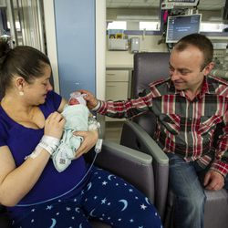 Marzena Nawracaj holds one of her newborn quadruplets at Lutheran General Hospital. | provided