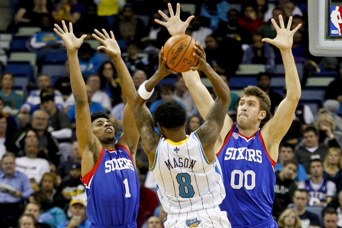Roger Mason gets swarmed by Nick Young and Spencer Hawes at The Hive Wednesday night
