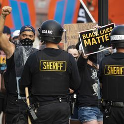 Protesters face off with police outside the Kenosha County Courthouse in the second night of unrest after police shot Jacob Blake, Monday night, Aug. 24, 2020.