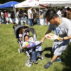 Volunteer Tedd Mills helps transport children as homeless residents are treated to a picnic lunch in Pioneer Park in Salt Lake City on Sunday, Aug. 27, 2017. Participants also received a new blanket and listened to live music.