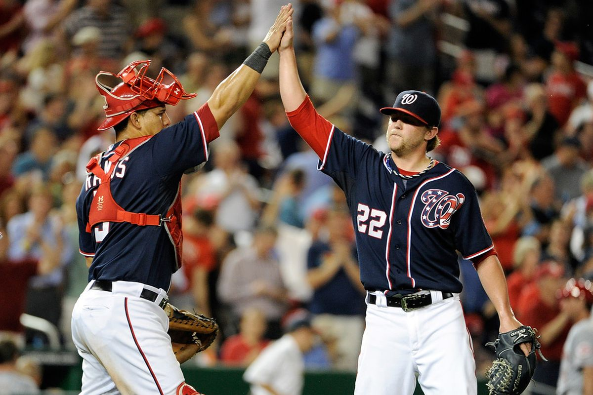 WASHINGTON, DC - AUGUST 16:  Drew Storen #22 of the Washington Nationals celebrates with Wilson Ramos #3 after a 6-4 victory against the Cincinnati Reds at Nationals Park on August 16, 2011 in Washington, DC.  (Photo by Greg Fiume/Getty Images)