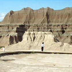 Visitors walk the quarter-mile fossil loop, one of several hikes at Badlands National Park.