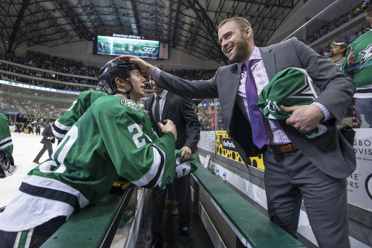 Peverley celebrating with Cody Eakin after a win that clinched a playoff spot in 2013-14