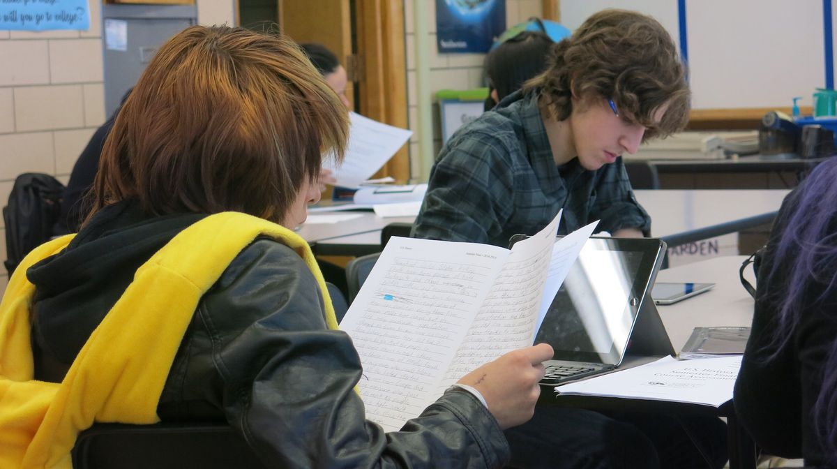 """Students in a mixed-grade high school history class at Kunsmiller Creative Arts Academy work on a """"Document-based question."""""""