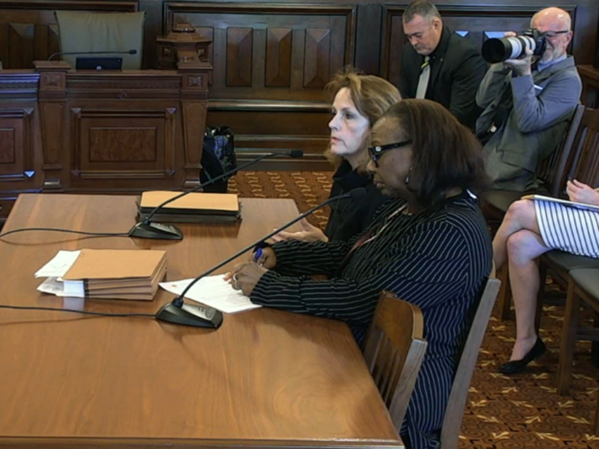 Lori Healey (rear), CEO of the Metropolitan Pier and Exposition Authority, and state Sen. Mattie Hunter (D-Chicago) testify in favor of an expanded restaurant tax to support McCormick Place.
