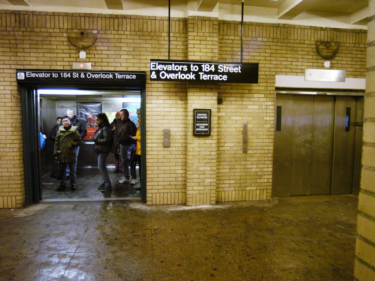 Subway riders take the elevator at the 181st Street and Fort Washington station.