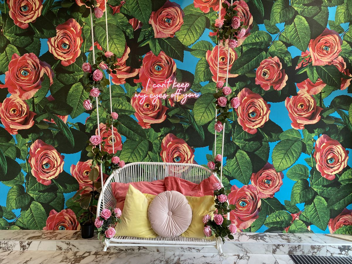 hanging swing with roses in the background wallpaper