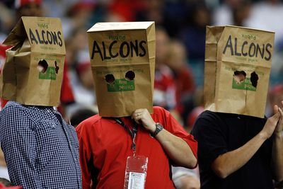 Fans of the Atlanta Falcons watch the game with bags on their heads against the New Orleans Saints on December 10, 2007 at the Georgia Dome.