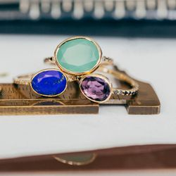 """The <a href=""""https://catbirdnyc.com/shop/product.php?productid=19646&cat=0&page=1"""">Clea</a> ring in chrysoprase and black diamonds ($928, top); the 14k <a href=""""http://shopthemansion.com/collections/jewelry/products/14k-lapis-with-white-diamonds"""">lapis wi"""