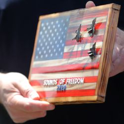 A plaque is presented to the firefighters of Fire Station No. 51 as organizers of the Sounds of Freedom Festival delivered Little Caesars Pizza to the first responders on Friday, May 15, 2020. Festival organizers dropped off pizzas at the Davis County Sheriff's Office, the Farmington Fire Department, and the Layton and Clearfield fire departments.