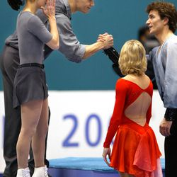 Canadian silver medalists figure skating pair Jamie Sale and David Pelletier, left, congratulate Russian gold medalist Elena Berezhnahya and Anton Sikharulidze on Tuesday, Feb. 12, 2002.