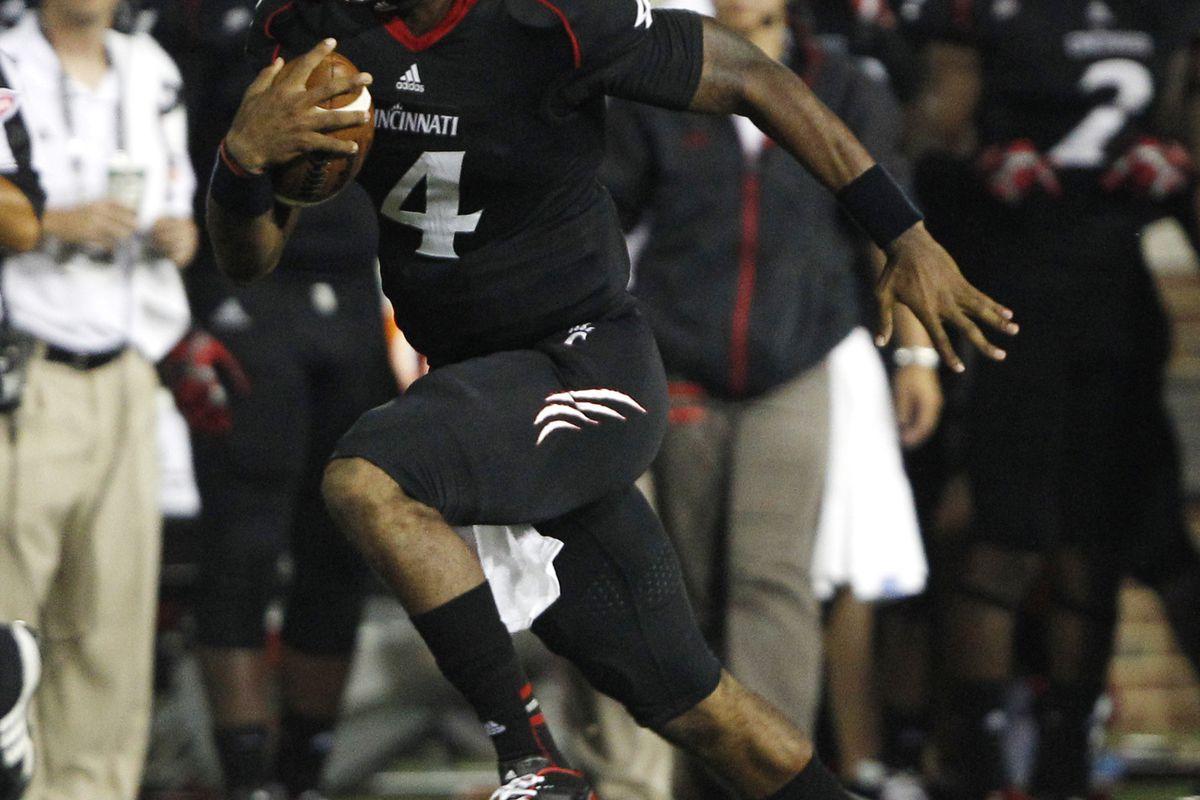 Sep 6, 2012; Cincinnati, OH, USA; Cincinnati Bearcats quarterback Munchie Legaux (4) runs for yardage during the first half against the Pittsburgh Panthers at Nippert Stadium. Mandatory Credit: Frank Victores-US PRESSWIRE
