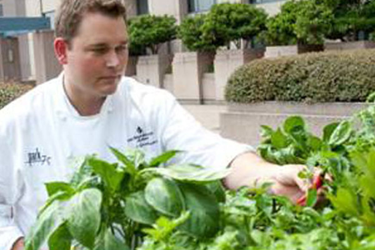 Park 75 Executive Chef Robert Gerstenecker working in the garden at The Four Seasons Atlanta. Photo by Cliff Robinson.