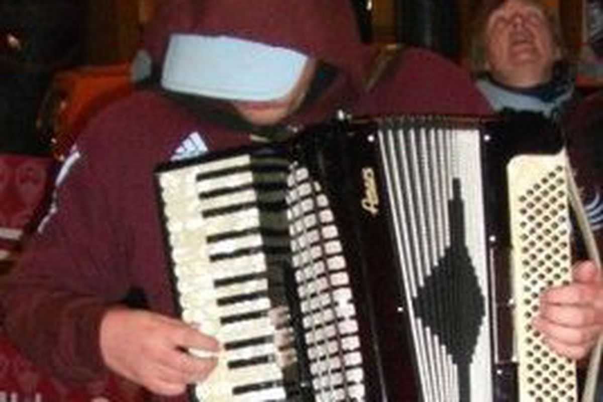 Can't find a good picture for this so here's me with an accordion.