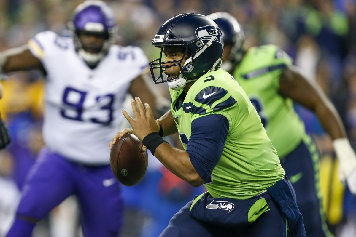 Seattle Seahawks quarterback Russell Wilson scrambles against the Minnesota Vikings during the first quarter at CenturyLink Field.