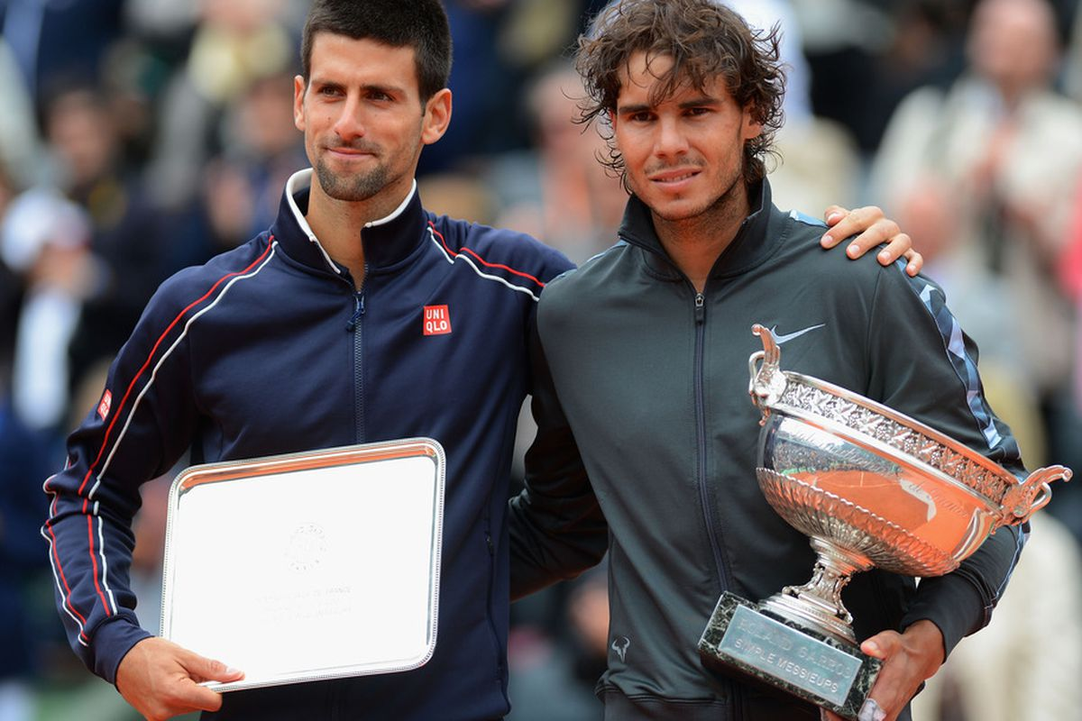 PARIS, FRANCE - JUNE 11:  Novak Djokovic of Serbia poses with Rafael Nadal of Spain after the men's singles final during day 16 of the French Open at Roland Garros on June 11, 2012 in Paris, France.  (Photo by Mike Hewitt/Getty Images)
