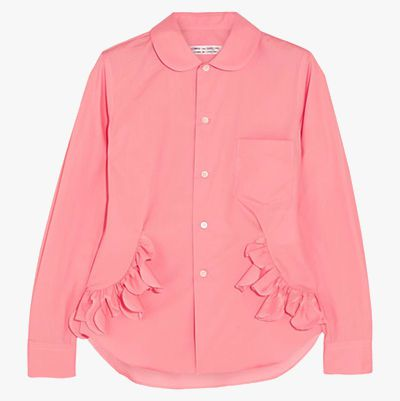 Pink button-down shirt with ruffle detailing.