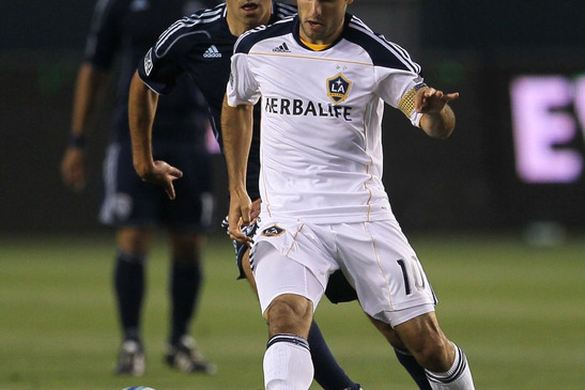 CARSON, CA - MAY 14:  Landon Donovan #10 of the Los Angeles Galaxy controls the ball in front of Davy Arnaud #22 of Sporting Kansas City at The Home Depot Center on May 14, 2011 in Carson, California.  (Photo by Stephen Dunn/Getty Images)