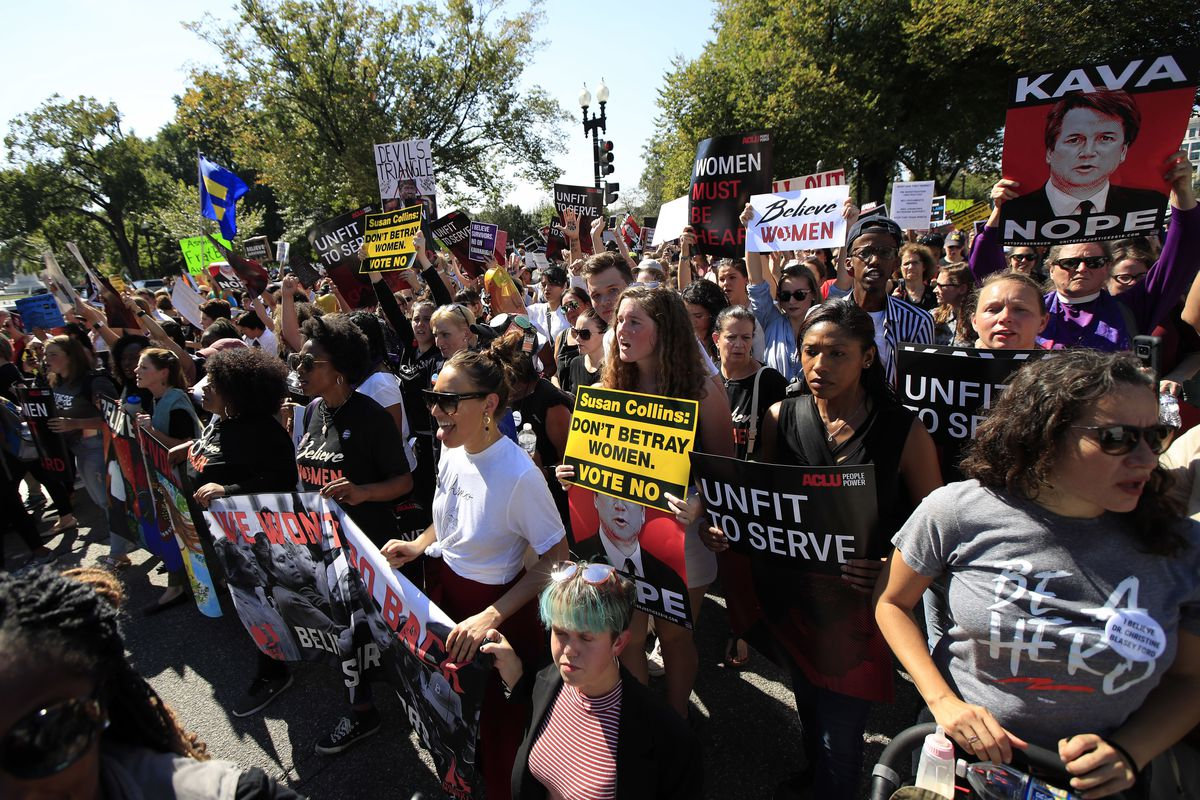Protesters march toward the Supreme Court as they demonstrate against Supreme Court nominee Brett Kavanaugh in Washington, Thursday, Oct. 4, 2018. (AP Photo/Manuel Balce Ceneta)