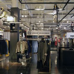 The men's department, complete with industrial accents and airborne mannequins.