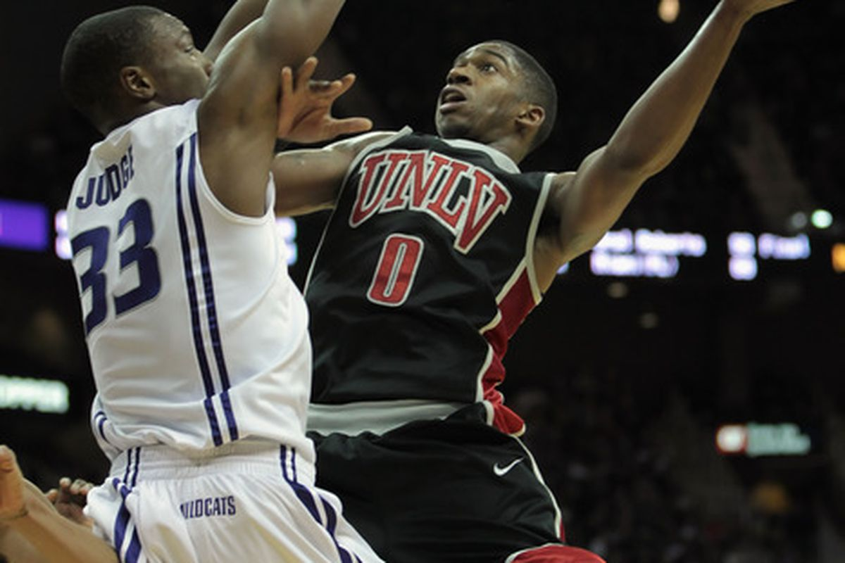 KANSAS CITY MO - DECEMBER 21:  Oscar Bellfield  #0 of the UNLV Rebels shoots over Wally Judge #33 of the Kansas State Wildcats during the game on December 21 2010 at the Sprint Center in Kansas City Missouri.  (Photo by Jamie Squire/Getty Images)